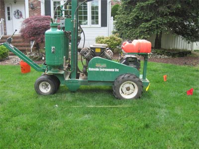 Photo of a Terralift machine on front lawn of a home; the Terralift aeration process is one of the procedures used in septic field restoration