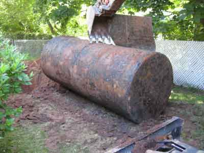 Photo of underground oil tank being prepared for removal from the yard of a residential property.